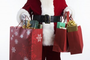 Santa Carrying Shopping Bags --- Image by © Royalty-Free/Corbis